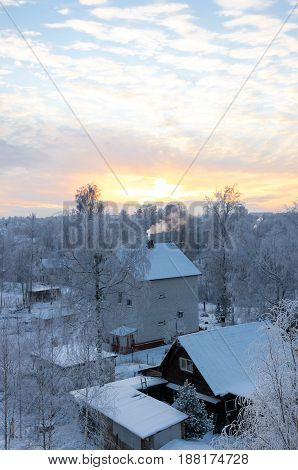 Sunset over the village in Leningrad region Russia