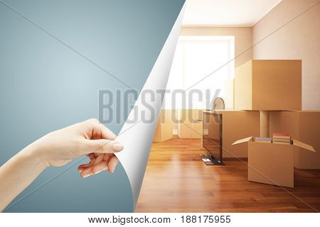 Girl's hand flipping abstract grey page revealing new room with moving boxes. Repairs concept. 3D Rendering