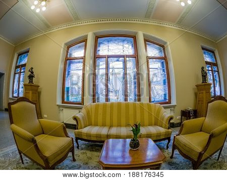 MOSCOW RUSSIA - APRIL 27 2017: Recreation area with chairs sofa and table in Metropol hotel in Moscow Russia on April 27 2017. Hotel was built in 1899-1907 in Art Nouveau style.