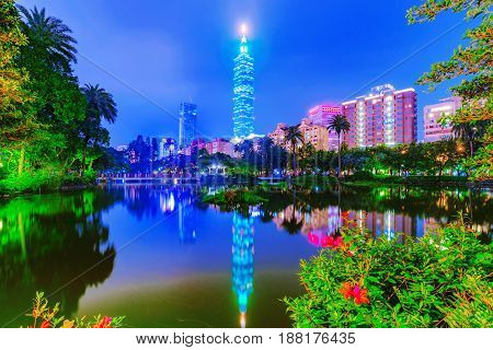 TAIPEI TAIWAN - APRIL 20: This is a night view of Zhonghsan park and Taipei the Taipei 101 building in the Xinyi district on April 20 2017 in Taipei