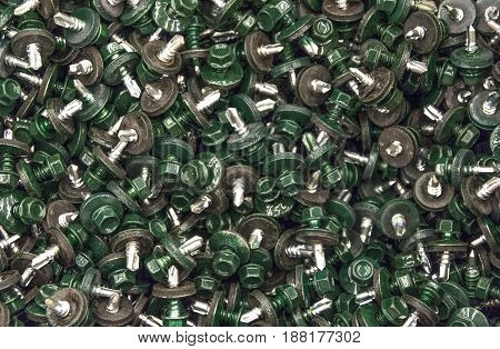 In the box are a lot of green roofing screws