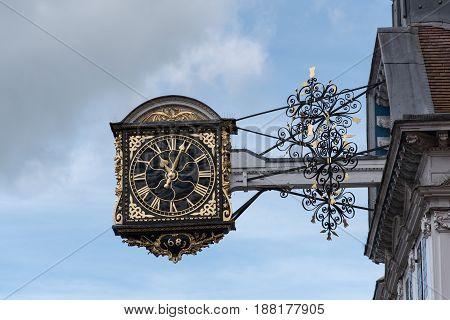 The clock overhanging Guildford High Street Guildford Surrey UK