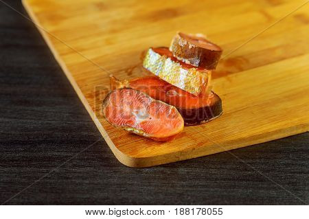 Fresh Raw Salmon , Red Tuna , And Sole Fish Pieces Over Wooden Board