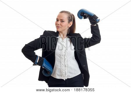 beautiful young girl in white shirt and jacket worth keeping hands in boxing gloves close-up isolated on white background