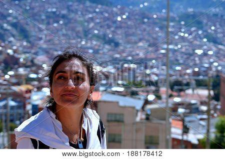 Proud contemplation of the city of La Paz, Bolivia