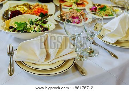 Empty Glasses Set With Napkin In Fine Dining Restaurant Decorated