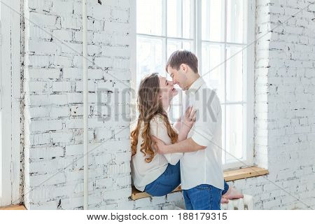 Young couple in love. Couple supporting each other and relying on each other having nice time together. Young happy woman hugging her handsome boyfriend. Portrait of cheerful casual people in love, students having hopes, dreams, goals