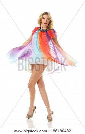 young pretty emotional woman dancing on white background