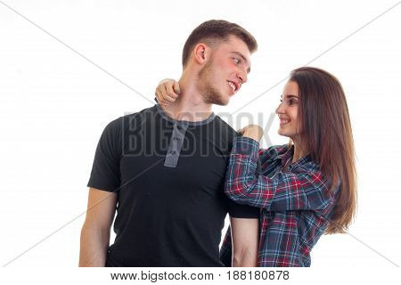 fun romantic couple standing near and stare at each other close-up isolated on white background