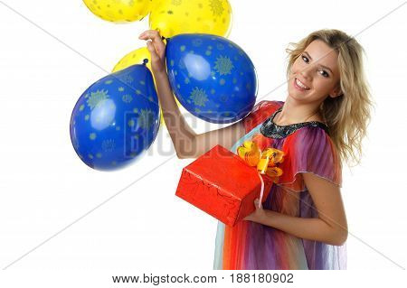 young beautiful female holding present and bunch of blue and yellow balloons studio isolated on white background