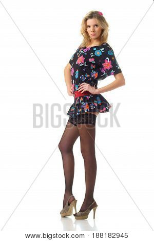 young woman wearing mini dress and black stockings isolated on white background