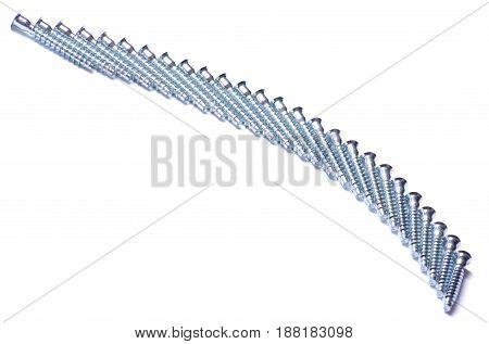 Many furniture screws on white background isolation