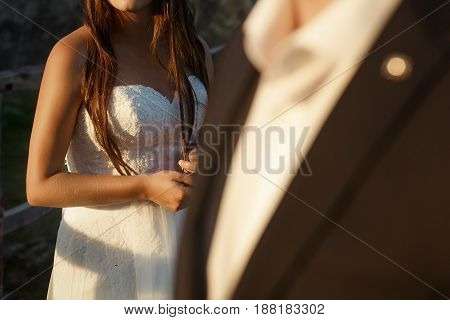 Gorgeous Wedding Couple Embracing In Sunlight. Happy Stylish Bride And Groom Posing In Evening Sun L