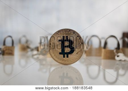 Gold Bitcoin Coin Near Padlocks