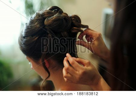 Hair Stylist Making Hairdo For Bride In The Morning