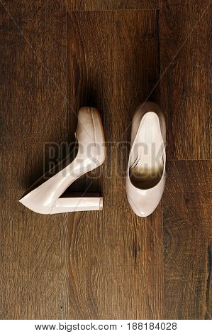 Beautiful Beige Shoes On Wooden Floor In The Morning, Bridal Morning, Wedding Preparation. Top View
