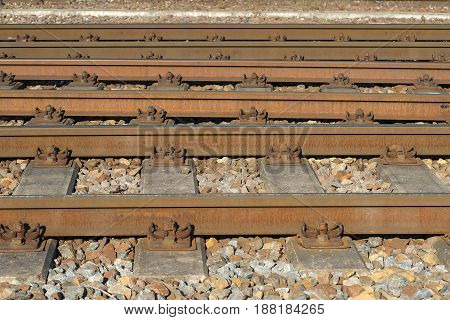 Fragment of railroad tracks, rails and sleepers on gravel