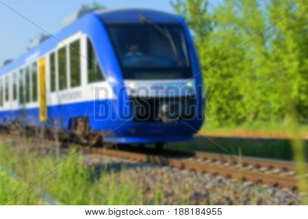 Blurred background texture, express rushes by rail in defocus