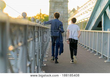 people kids walked andreevsky bridge in Moscow