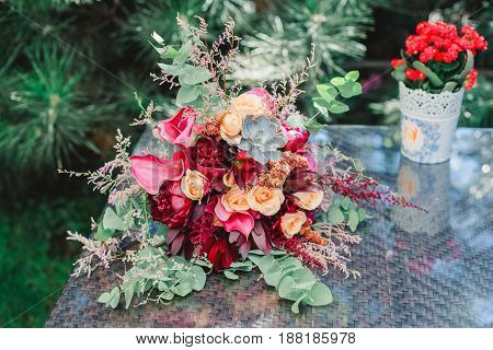 Bouquet of flowers on the vintage table Wedding decoration hand made.
