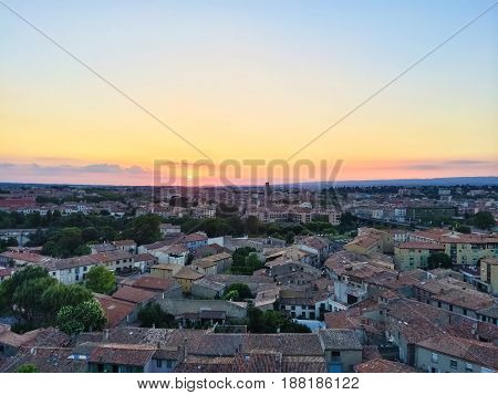 Rooftops of the picturesque town in sunset. Carcassonne France.