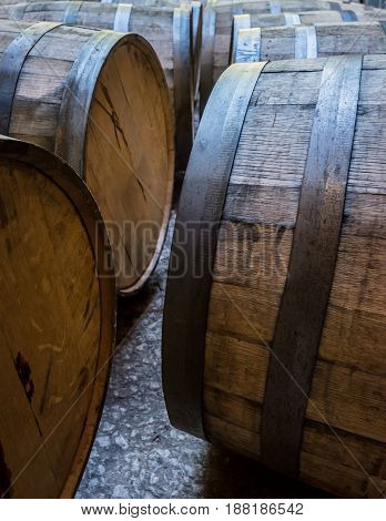 Old Bourbon Barrels Laying on Their Sides in storage