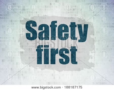 Protection concept: Painted blue text Safety First on Digital Data Paper background with  Scheme Of Binary Code
