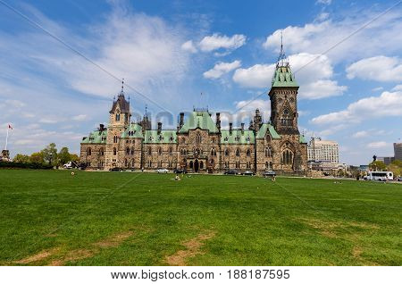 Parliament Hill , colloquially known as The Hill, is an area of Crown land on the southern banks of the Ottawa River in downtown Ottawa, Ontario. Its Gothic revival suite of buildings is the home of the Parliament of Canada and has architectural elements
