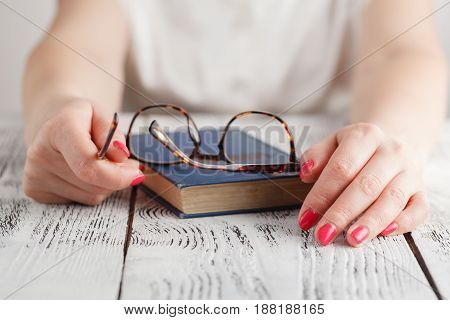 Close Up Of Eye Glasses On Text Book In Library. Education Concept