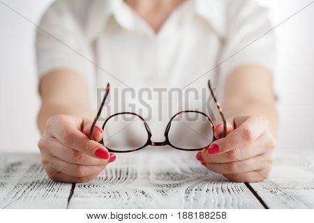 Senior business woman portrait with eyeglasses .