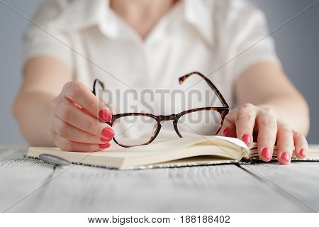 Education And Business Concept - Businesswoman Wearing Eyeglasses In Office