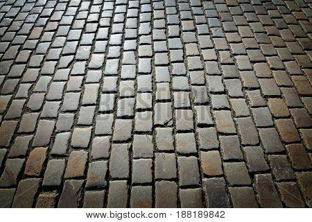 Antique cobblestone road shined bright sun. Background