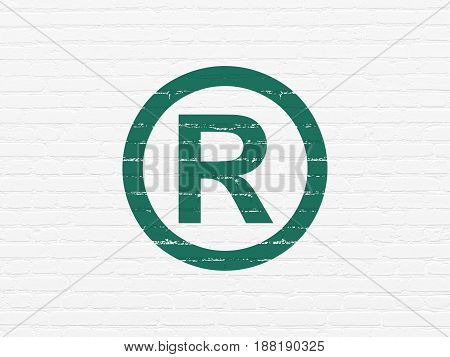 Law concept: Painted green Registered icon on White Brick wall background