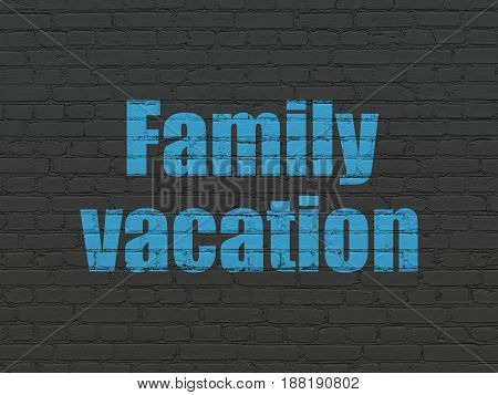 Tourism concept: Painted blue text Family Vacation on Black Brick wall background
