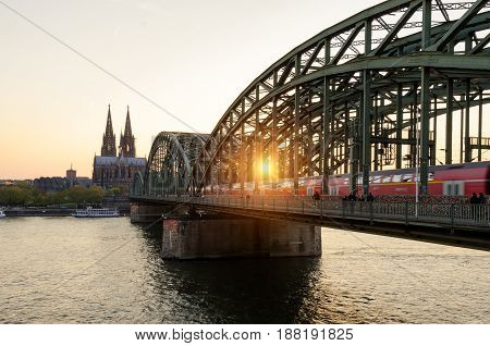 Cologne Germany. Image of Cologne with Cologne Cathedral and railway during sunset in Germany.
