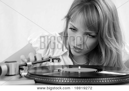 The Girl Listens To A Vinylic Disk