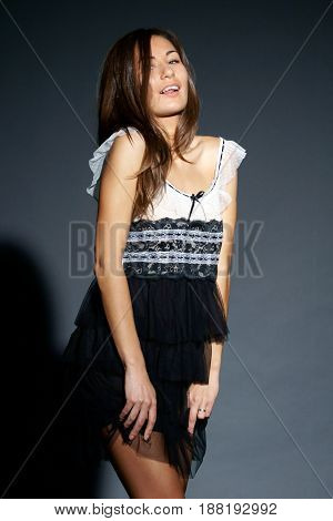fashion style studio photo of young beautiful female in summer dress
