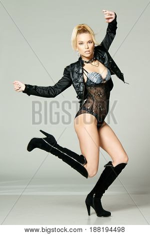 studio fashion style photo of young beautiful and sexy woman in dynamic pose
