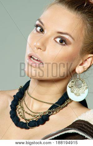 studio fashion style portrait of young beautiful blond woman