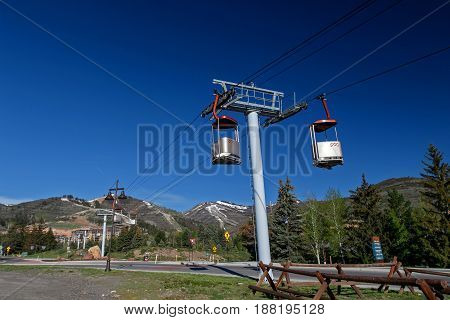 Park City UT May 12 2017: Cabins of the Cabriolet lift in Canyons resort are suspended in the air. The cable lift transports skiers to the mountain base.