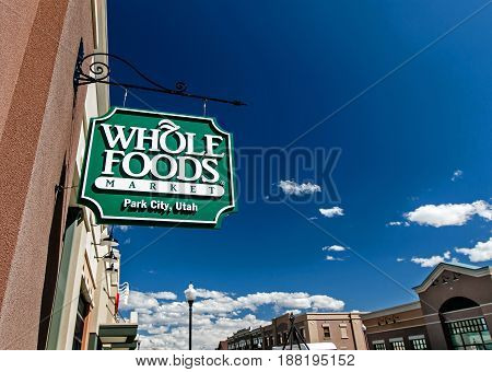 Park City UT May 12 2017: Whole Foods Market sign is suspended by an entrance to the grocery store.