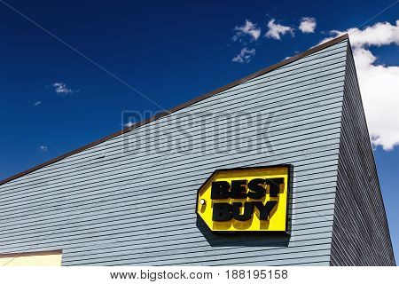 Park City UT May 12 2017: Bright sun lights up the sign on a Best Buy electronics store at Kimball Junction.