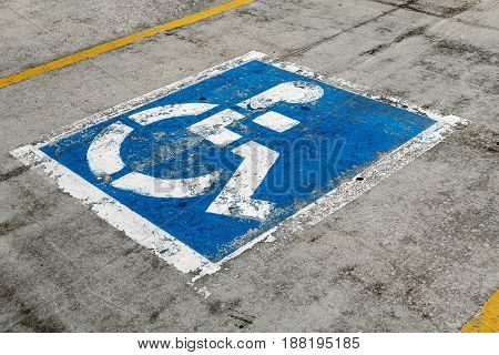Worn out sign for handicapped parking spot.