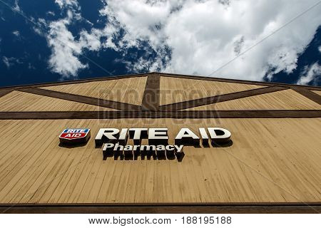 Park City UT May 12 2017: Rite Aid pharmacy sign above the entrance to the drug store is lit by the sun.