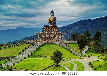 Beautiful huge statue of Lord Buddha at Rabangla Sikkim India. Surrounded by Himalayan Mountains it is called Buddha Park - a popular tourist attraction.