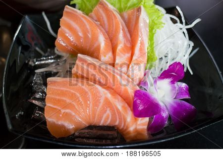 Sliced Salmon Sashimi Served On Black Plate stock photo