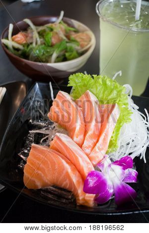 Set Of Sliced Salmon Sashimi And Green Tea stock photo