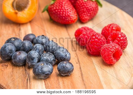 Wooden Board With Fresh Organic Fruit And Berries