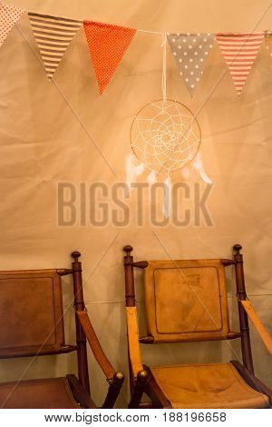 Multi colored triangle flags hanging indoor party stock photo