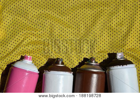 Several Used Aerosol Paint Sprayers Lie On The Sports Shirt Of A Basketball Player Made Of Polyester